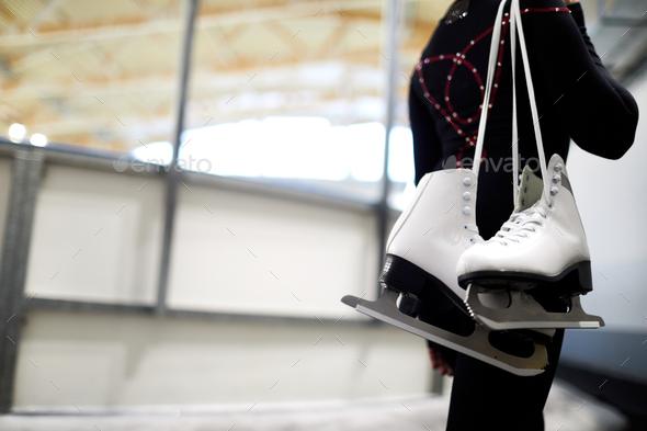 Girl Holding Figure Skates - Stock Photo - Images