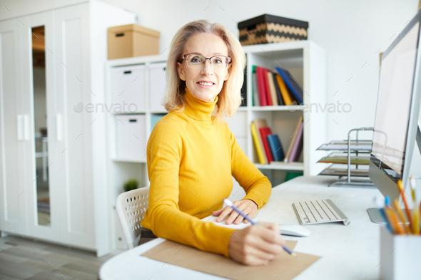 Mature Businesswoman at Desk - Stock Photo - Images