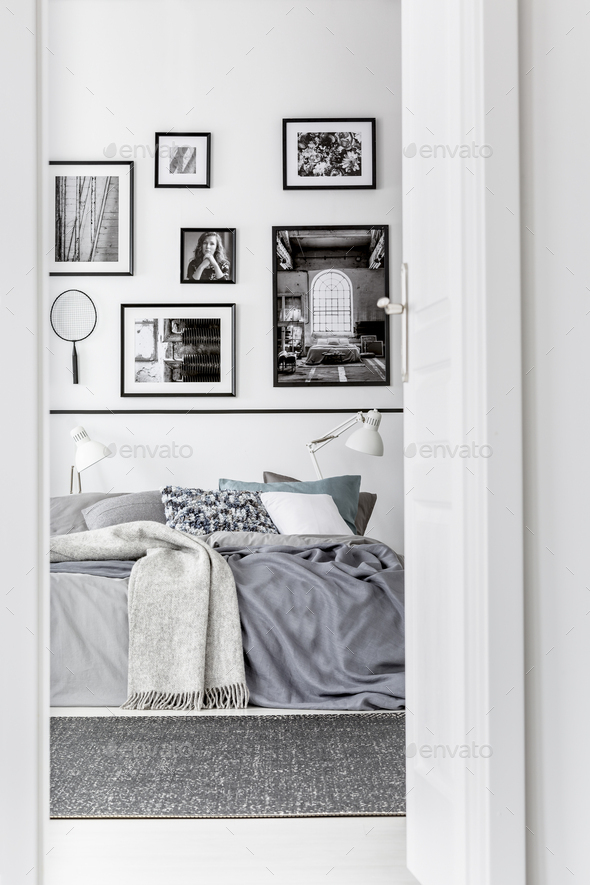 Trendy bedroom with comfortable king size bed in modern flat, real photo - Stock Photo - Images