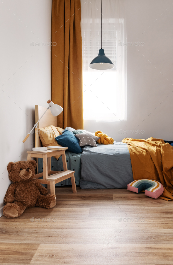 Stylish blue and orange kid's bedroom design in bright apartment - Stock Photo - Images