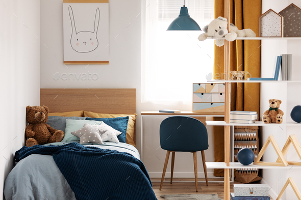 Workspace with desk and chair in elegant teenager's room with blue and orange design - Stock Photo - Images