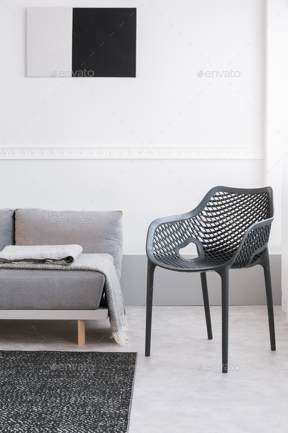 Monochrome living room interior with fancy grey chair and sofa - Stock Photo - Images