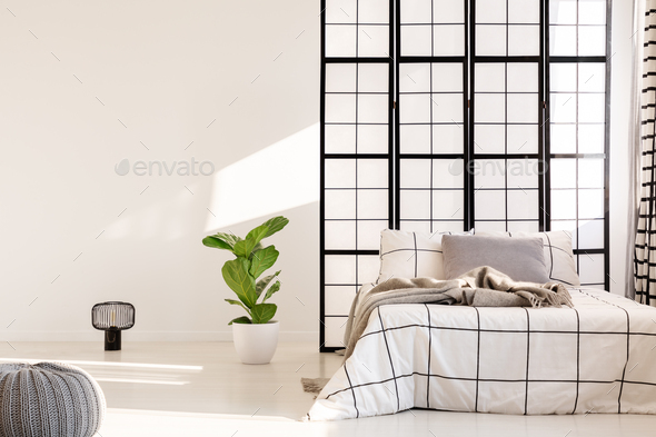 Black and white bedroom design with mullions wall - Stock Photo - Images
