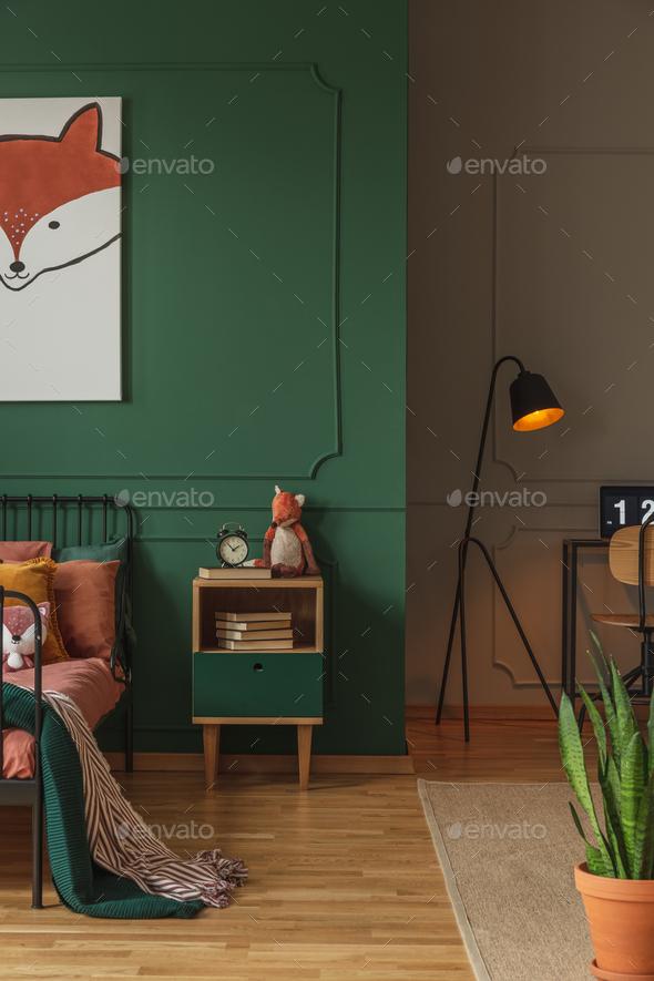 Fox head on vertical poster in emerald green teenager bedroom - Stock Photo - Images
