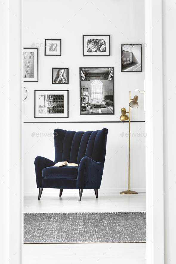 Trendy wing back chair in fancy bedroom interior with elegant furniture - Stock Photo - Images