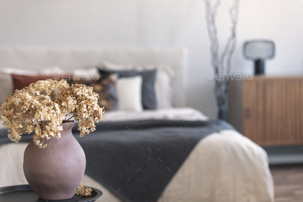 Brown flowers in pottery - Stock Photo - Images