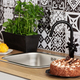 Cake, Herbs and fruits on kitchen counter in bright kitchen interior with trendy tiles on the wall - PhotoDune Item for Sale