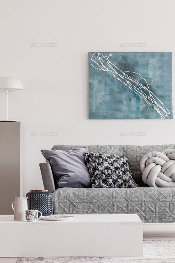 Abstract blue painting on empty white wall of open plan apartment - Stock Photo - Images