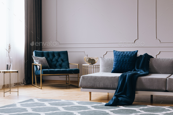 Pillows and blanket on modern sofa in bright living room interior - Stock Photo - Images