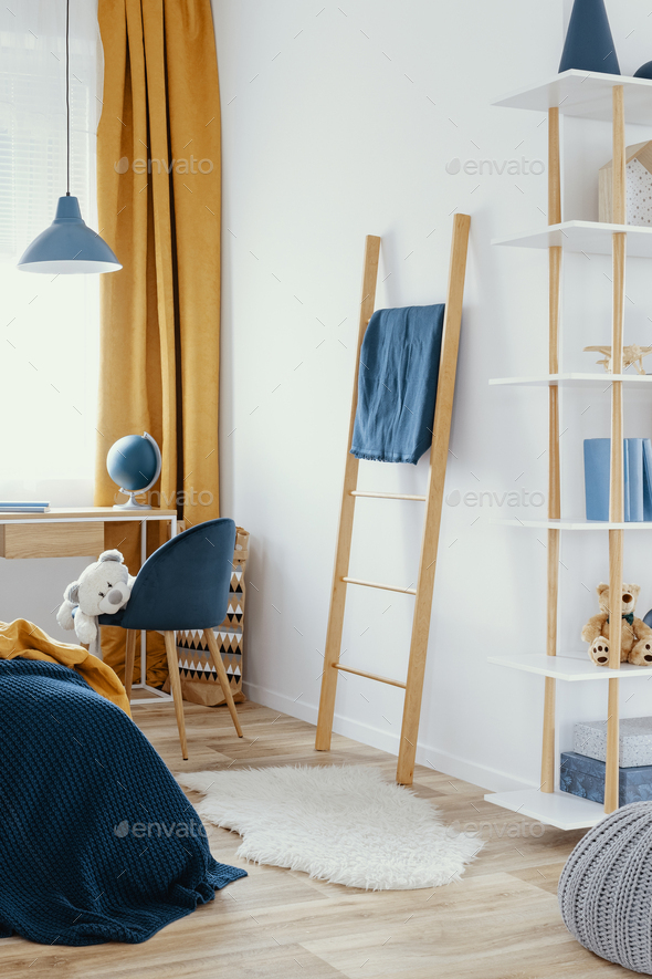 Contemporary bedroom and workspace teenager room with orange curtains - Stock Photo - Images