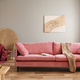 Wicker peacock chair with red blanket behind pink velvet couch - PhotoDune Item for Sale