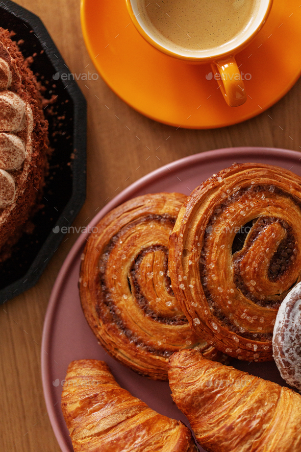 Top view of sweet food and coffee on wooden counter - Stock Photo - Images