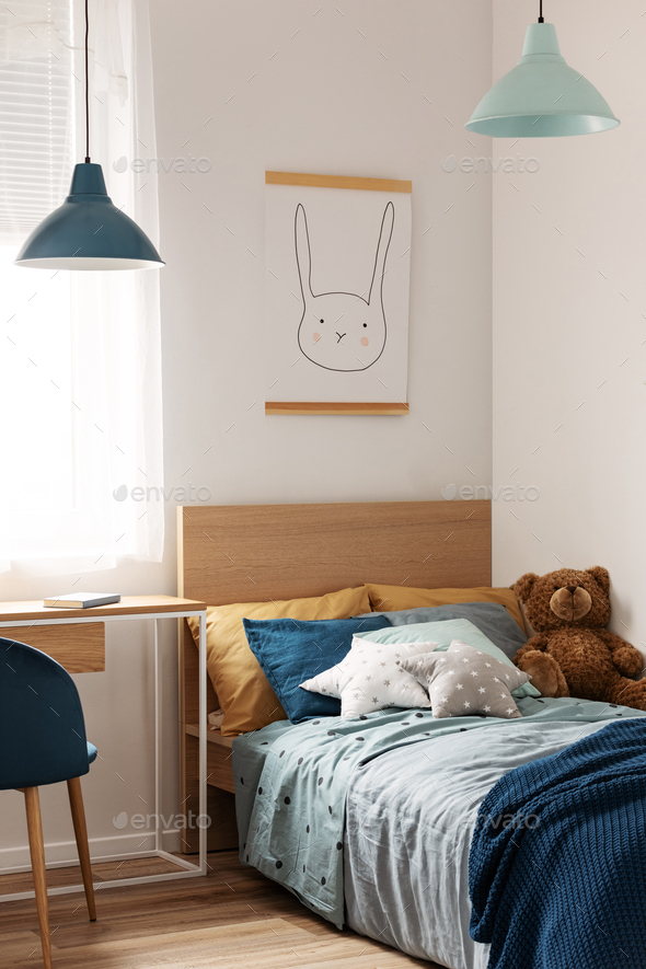 Pastel blue and mint accents in cozy children's bedroom - Stock Photo - Images