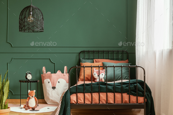 Copy space on empty dark green wall of trendy bedroom interior - Stock Photo - Images