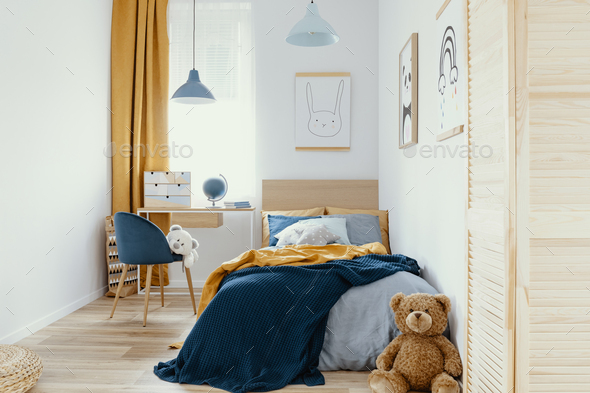 Multifunctional bedroom and workspace interior with bed and desk - Stock Photo - Images