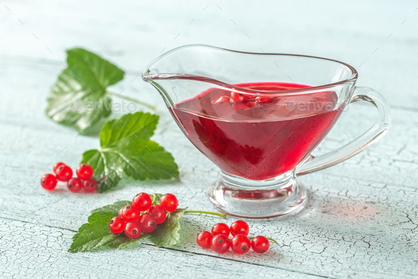 Glass boat of red currant jam - Stock Photo - Images
