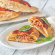 Homemade calzone on the plate - PhotoDune Item for Sale