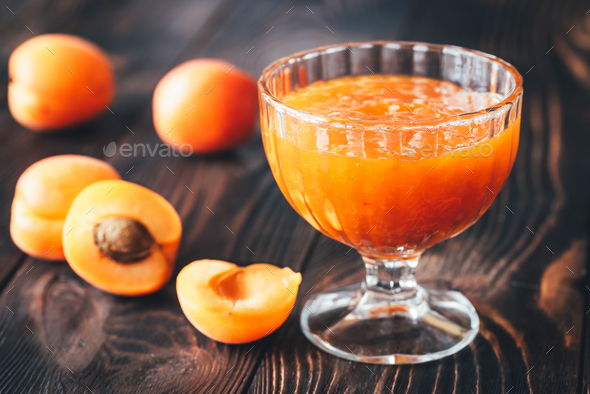 Glass vase of apricot jam - Stock Photo - Images
