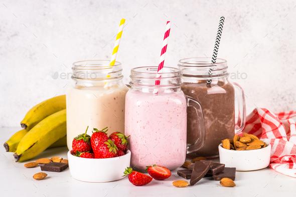 Banana, chocolate and strawberry milkshakes - Stock Photo - Images