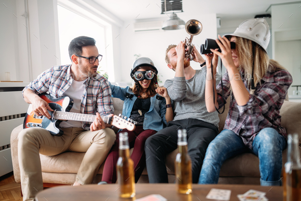 Happy young friends having fun and partying to music - Stock Photo - Images