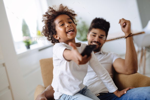 Portrait of father and daughter playing at home - Stock Photo - Images