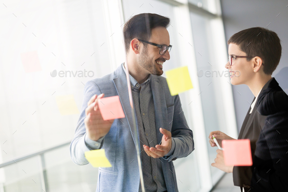 Creative business people working on business project in office - Stock Photo - Images