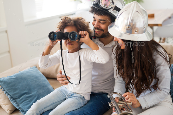 Happy young family relax and have fun at home - Stock Photo - Images