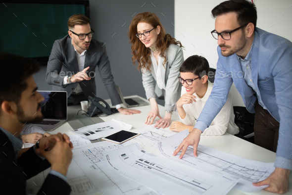 Successful business colleagues in modern conference room - Stock Photo - Images