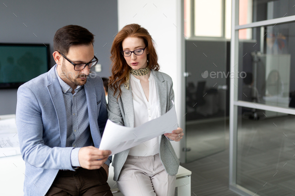 Business colleagues in conference meeting room during presentation - Stock Photo - Images