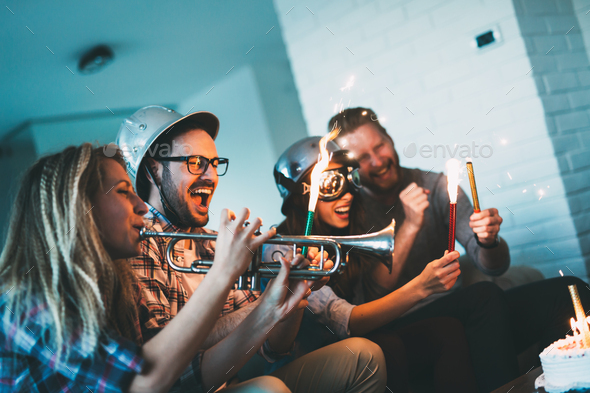 Group of friends enjoying and celebrating birthday and partying - Stock Photo - Images