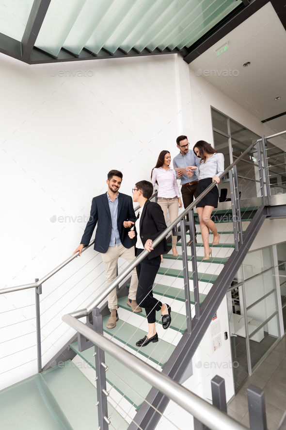 Corporate teamworking colleagues in modern office - Stock Photo - Images