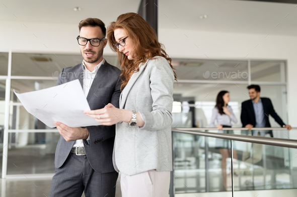 Corporate teamworking colleagues in bright modern office - Stock Photo - Images
