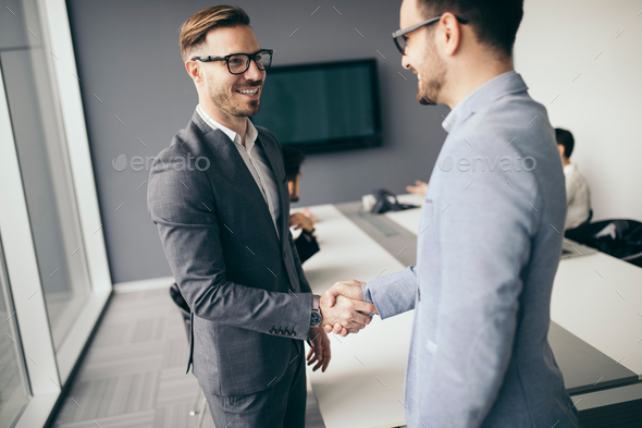 Business people shaking hands, finishing up meeting - Stock Photo - Images
