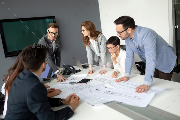 Group of architects working on new project - Stock Photo - Images