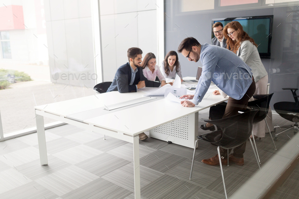 Business colleagues in conference room working together - Stock Photo - Images