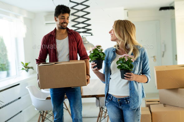 Beautiful couple happy for their new home - Stock Photo - Images