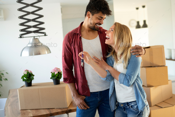 Young Couple Moving In To New Home Together - Stock Photo - Images
