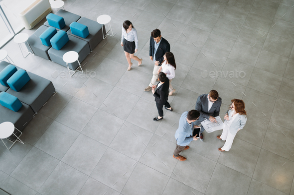 Professional business people working together on project - Stock Photo - Images