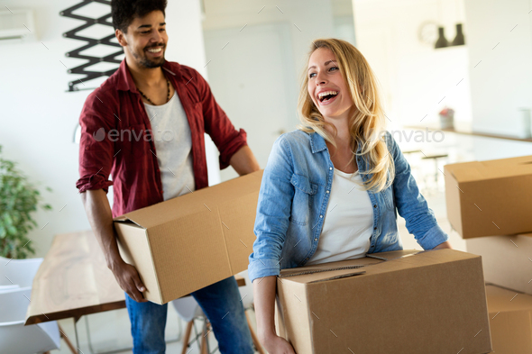 happy couple having fun while moving in - Stock Photo - Images