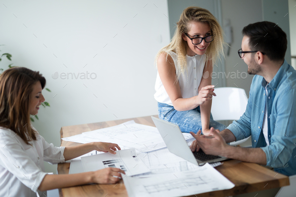 Coworkers discussing new ideas and brainstorming in a modern office - Stock Photo - Images