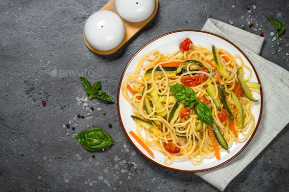Pasta spaghetti with zucchini, carrot and tomato - Stock Photo - Images