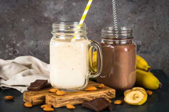 Banana and chocolate milkshakes in jars - Stock Photo - Images