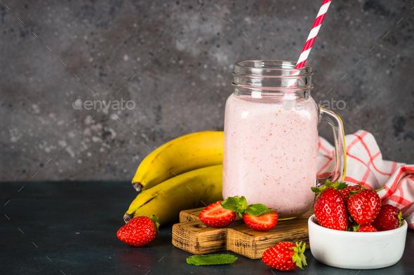 Strawberry milkshake or smoothie in mason jar - Stock Photo - Images
