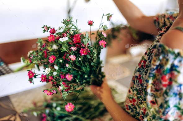 Florist is collecting a bouquet of fresh white and pink chrysanthemums - Stock Photo - Images