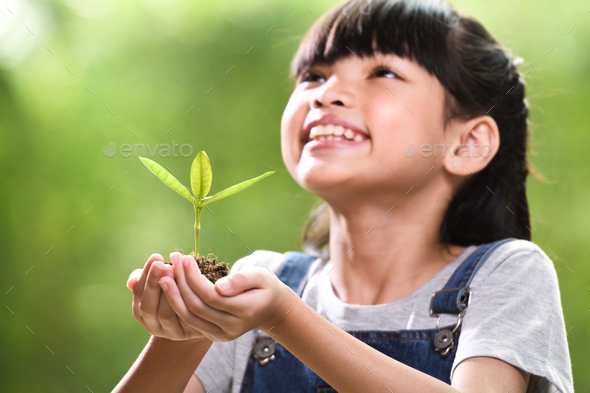 Girl and Young plant - Stock Photo - Images