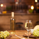 Bowl of golden honey jar next to fresh grapes and wolnuts over a wooden table - PhotoDune Item for Sale