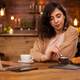 Beautiful woman eating delicious chocolate cake in a coffee shop - PhotoDune Item for Sale