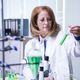 Female biologist wearing a white coat for academic research - PhotoDune Item for Sale