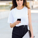 Businesswoman working with her smart phone and laptop outdoors - PhotoDune Item for Sale