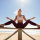 Caucasian blonde woman practicing yoga in the beach - PhotoDune Item for Sale